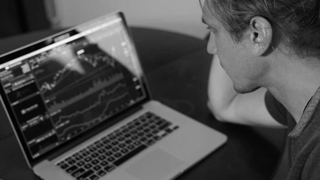 Man watching stock prices intently