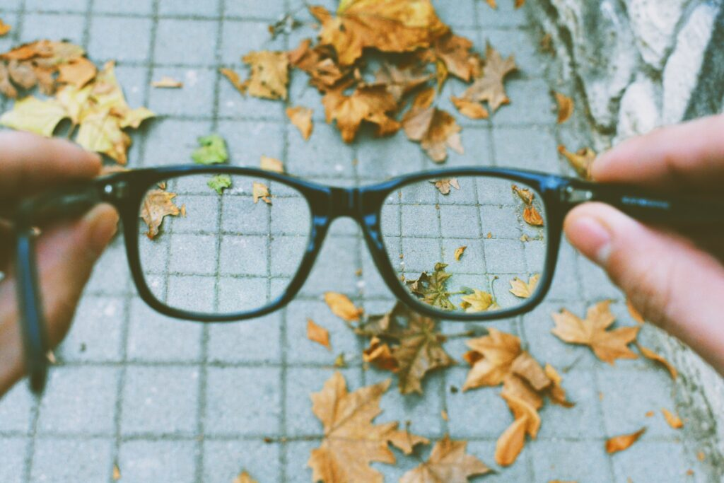 Viewer looking through glasses with blur around them