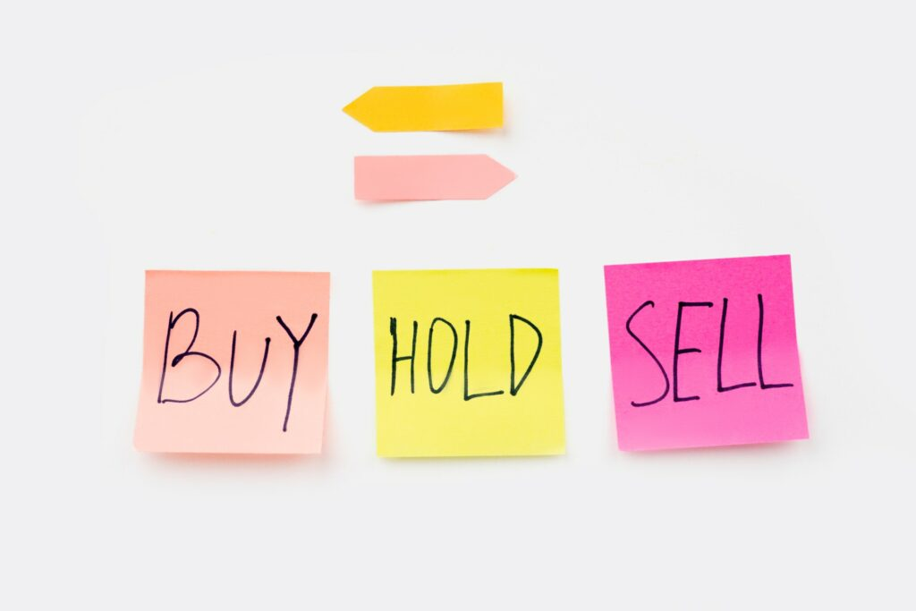 "Sticky notes that read ""BUY"" ""HOLD"" ""SELL"""