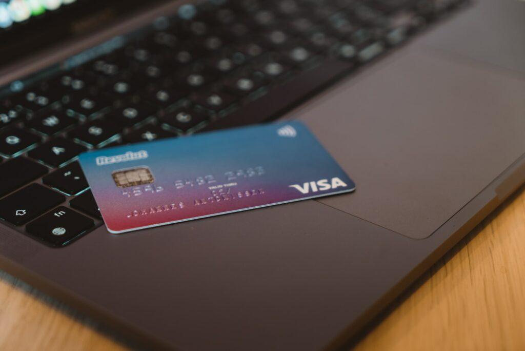 Visa Card sitting on Laptop