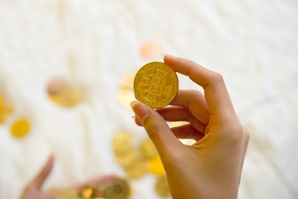 Hand holding up a Bitcoin